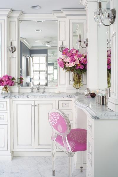 White bathroom w/ granite countertops accented in fushia