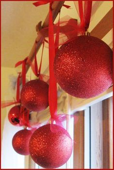 DIY ornaments. Styrofoam covered in glitter. Much less expensive than the big ornaments at the store.  Make some of these for outside ornaments.