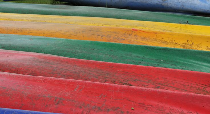 Coriosi – We do it with passion! A Finnish communications agency. Photo of canoes by Coriosi.