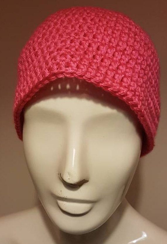 This listing is for  Pink messy bun hat  This hat has been made in a beanie style and has a elasticated hole in the top which is perfect for threading your ponytail through.  This hat is made in pink and will cover most of the ears  It is one size fits most teenage children and adults This hat can also be made in other colours and sizes so please ask  I aim to post within 3 working days of receiving cleared payment but if you need it any sooner then please ask