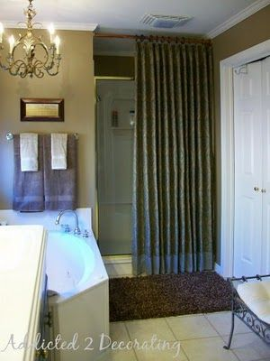 I have the same brass shower and what a creative way to hide it!!!  Now I can finish my bathroom! (But would it get too moist??)    addicted2decorating.com