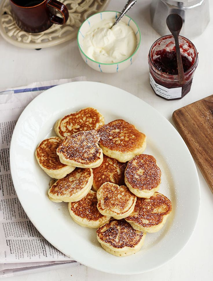 'Racuszki' or Racuchy  {Polish Yeasted Pancakes}. They are typically served with sour cream and fruit preserves.