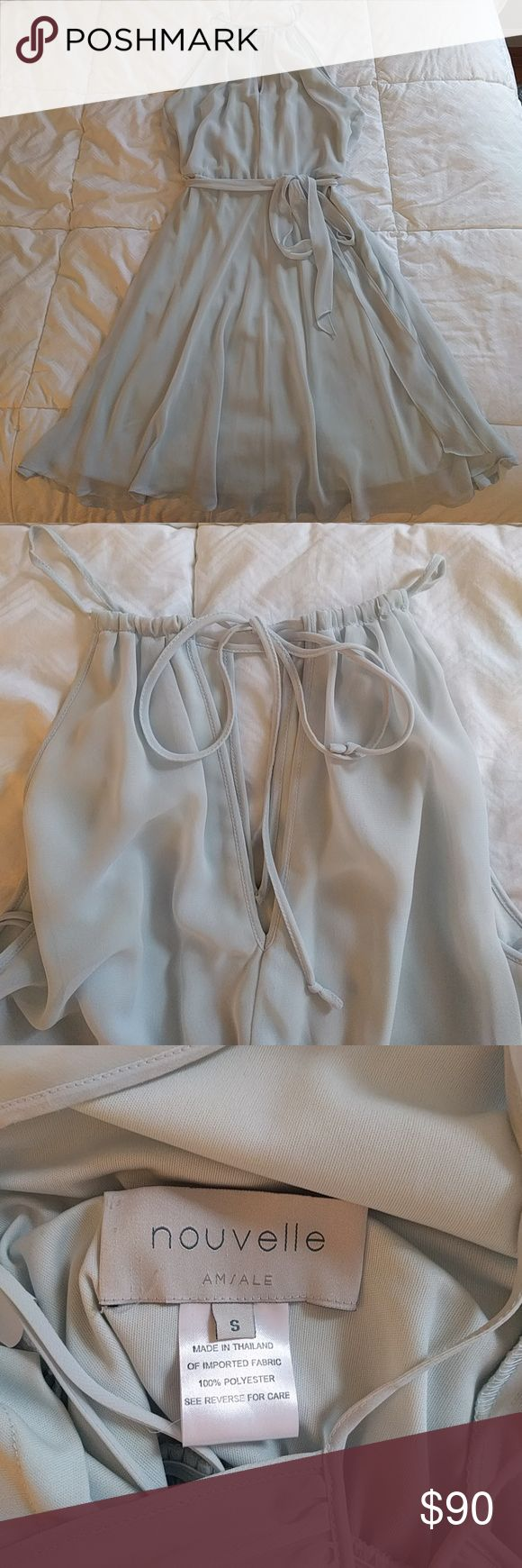 Nouvelle AMSALE halter keyhole neck Chiffon Dress Beautiful delicate dress with keyhole bodice and halter that ties in the back. A waist defining sash, A line, flattering. Color: cloud. Perfect for a bridesmaid looking for a soft blue dress. Wears with ease, no zippers Nouvelle Amsale Dresses