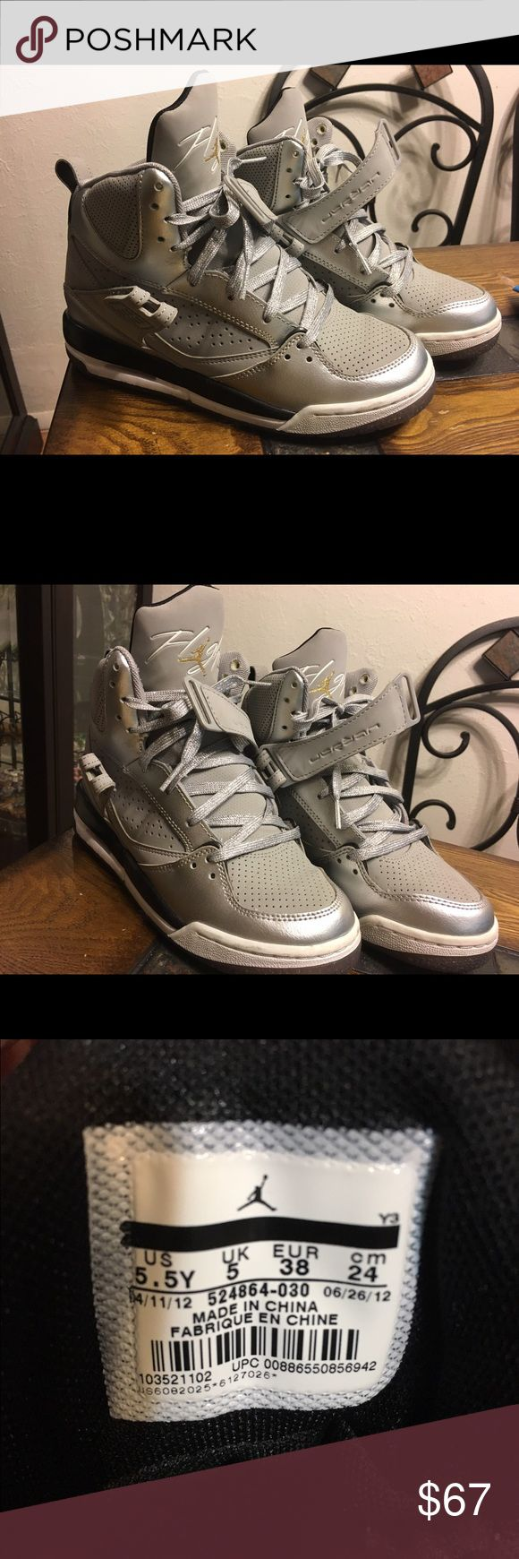 Air Jordan Flight shoes Silver and grey high top flight shoes with gold touch on symbol and on back. Like new. Got as a Christmas gift and only wore twice. Jordan Shoes Sneakers