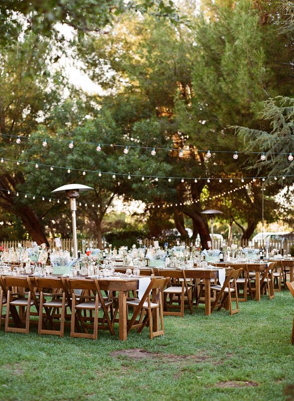 backyard wedding reception - photo by Majesta Patterson http://ruffledblog.com/a-sophisticated-food-truck-wedding #weddingideas #receptions