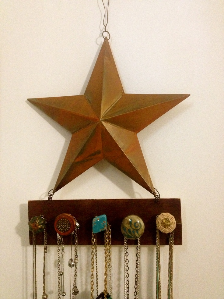 star from michaels, painted the wooden part dark brown, and gathered various knobs from hobby lobby $12