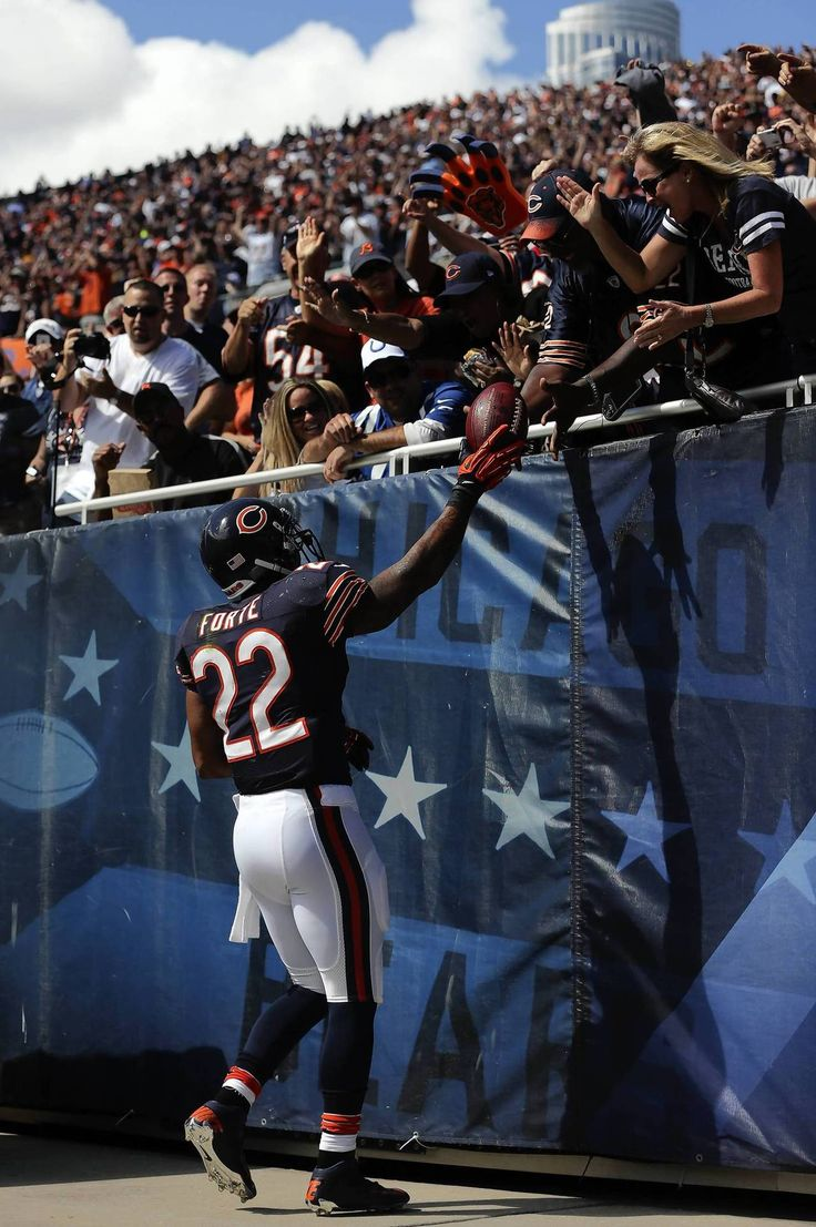 Chicago Bears' Matt Forte celebrates third quarter touchdown run by giving the ball to his father Gene during 41-21 win over Indianapolis Colts during NFL game at Soldier Field.
