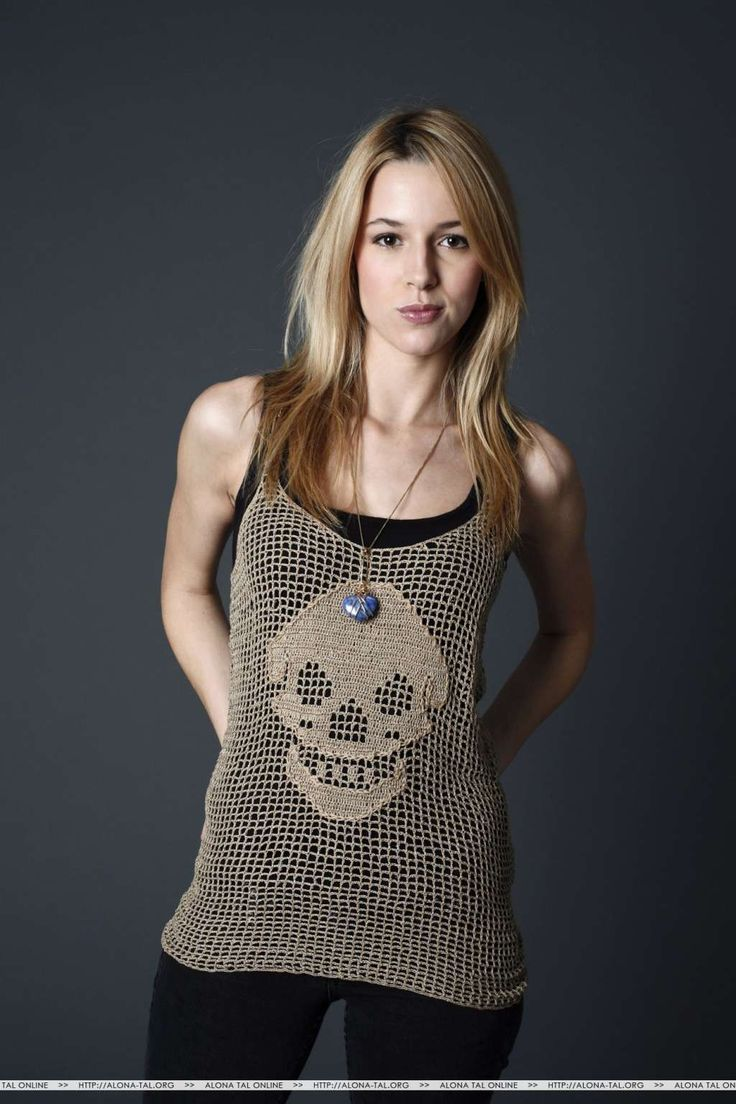 Alona Tal in a Layered Weaved Skull Design Top