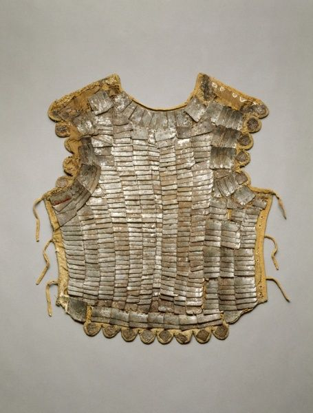"c. 1500-1525 linen, gold velvet, steel, and brass (22 3/16 x 18 11/16 in., 2.5 kg) ""The brigandine is a light, vestlike body defense popular with both knights and infantry from the 1400s through about 1550. It is constructed of multiple small plates attached to a cloth covering. Finer examples, like this one, are faced in velvet or fabric made of gold thread. The lightweight brigandine provided protection from the weather, and was extremely flexible."" Cleveland Museum of Art 1921.1250"