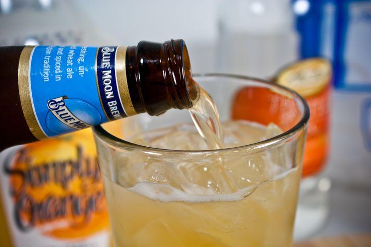 Blue Moon cocktail recipe. 1 shot clementine vodka, 1 shot triple sec, splash orange juice, Blue Moon.