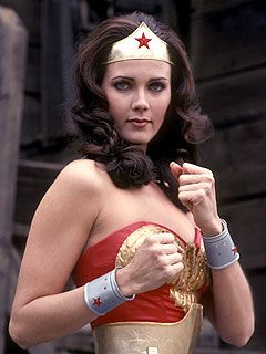 "My childhood idol. I had two silver cuff bracelets and a gold lasso that I got at the rodeo.  I used to run around in circles with the lasso yelling ""Wonder Woman!"" over and over when it came on.  I was maybe 5 at the time..."