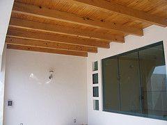 techumbre de vigas y duela de madera, casa en Milenio III
