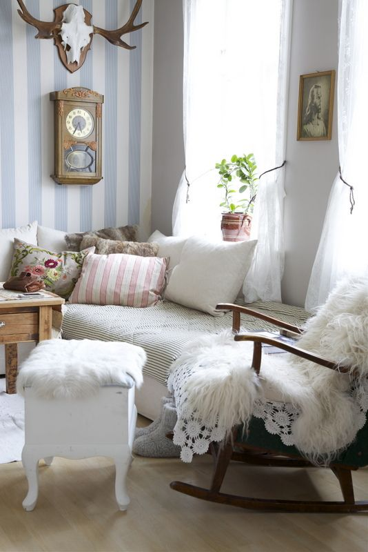 Cosy textiles and LOVE the striped wall