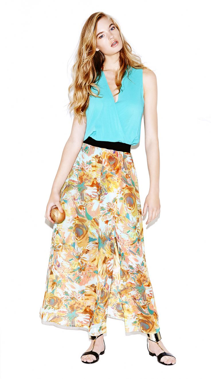 """Model wears Naughty Dog """"double theme"""" long dress, with blue upper part and flower print silk skirt; waist-cutted with a black elastic."""
