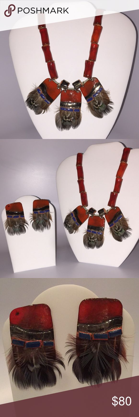 Western Porcelain Necklace and Earring Set. Beautiful can't come close when staring at this Western Porcelain with Feathers Necklace and Earring Set. The colors are reddish orange with blue as an accent color. Very beautiful for the discriminating woman. Jewelry Necklaces