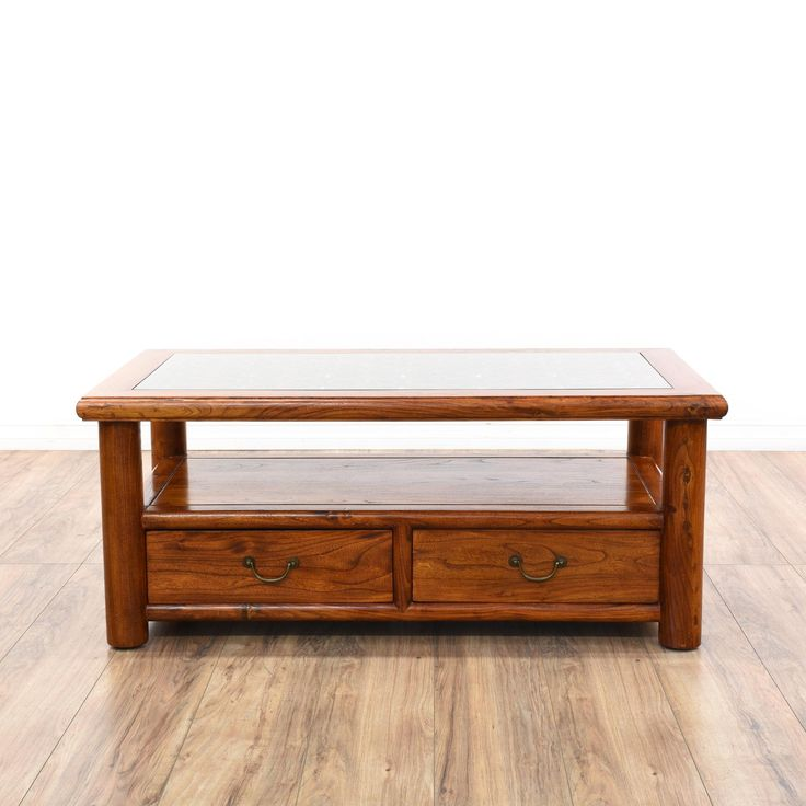 This asian coffee table is featured in a solid wood with a gorgeous glossy rosewood finish. This coffee table has 2 drawers, a bottom shelf tier and a carved floral latticework top with a glass insert. Stunning table perfect for storing magazines and remotes!  #asian #tables #coffeetable #sandiegovintage #vintagefurniture