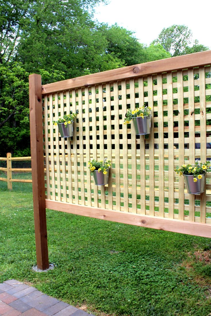 learn how to make this DIY wood privacy screen wall for $100