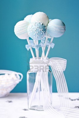 Blue and white cake pops - something for people to eat while waiting on bride and groom to take pictures. Just a few appetizers at the table in jars like this.  Cool!