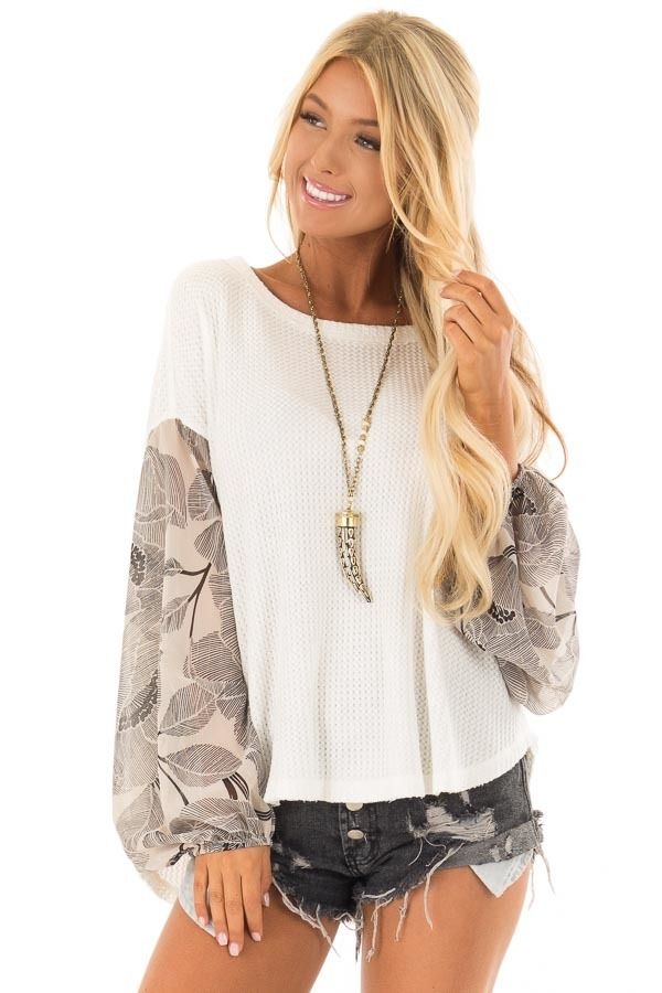 7ddef6050509f9 Ivory Waffle Knit Top with Flowy Black Floral Print Sleeves front close up