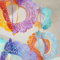 Paper doilies transformed into rainbow spinners. Perfect for parties, baby showers or a mobile.  reminds me of the  mexican banners