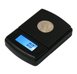 "At 3.5"" x 2.4"" x .8"", it is small enough to fit into your pocket or purse but hefty enough to weigh up to 600 grams (21 ozs)!"
