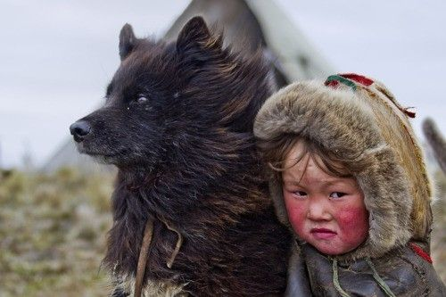 Child from the Nenet tribe, threatened nomadic reindeer herder tribe in Northern Siberia by Kempton