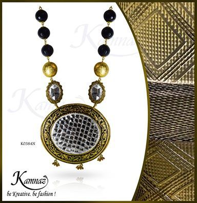 Elegant necklace with mirror work centre .black colour gives the royal touch