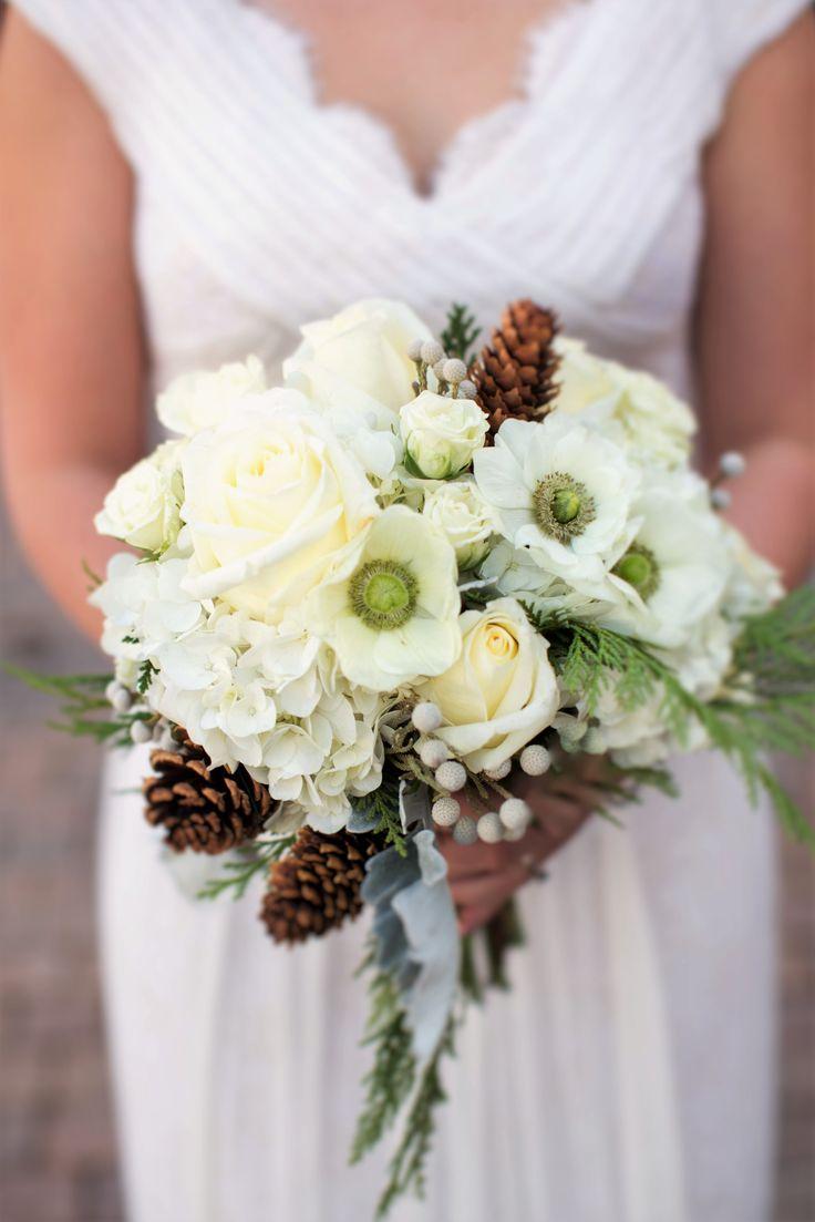 Beautiful winter bridal bouquet featuring green eyed anemones, pinecones, and cedar #Breckenridge #Florist #Flowers #Wedding  Florals by Petal & Bean Breckenridge, CO