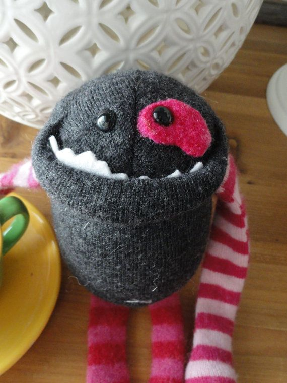 Smug Monsters, a whole line of upcycled sweater monsters.  No pattern, just supa dupa cute.
