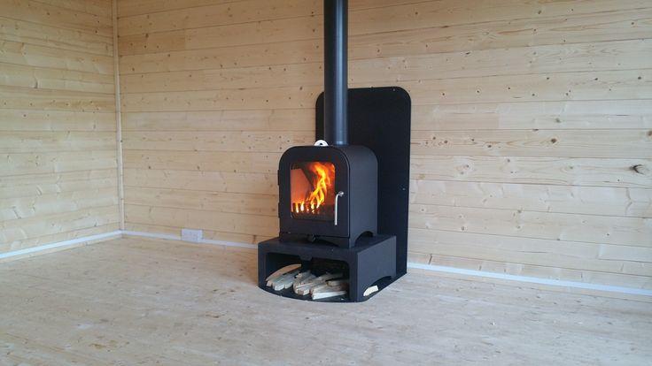 This lovelly shot of a Vesta V2 Woodburning stove installed in a Dunster Summer Hoiuse.  For further detail please check out http://www.vestastoves.co.uk/shop/summer-house-stove-installation-kit #logburner #woodburner #summerhouse #logcabin