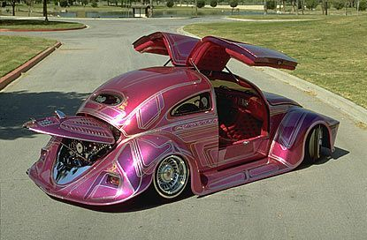 Wow... gull-wing doors on a bug. That a crazy car. I dig the crazy low rider paint and wild ...