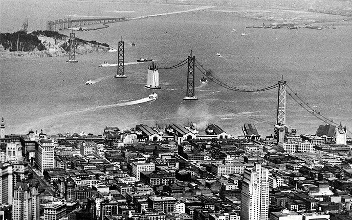 Aerial view of the San Francisco Oakland Bay Bridge under construction in 1935.