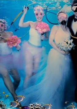 Dress # 20 It appears to consist of a swimsuit, a taffeta skirt, bathing cap, oxygen gir, swim goggles and flippers.