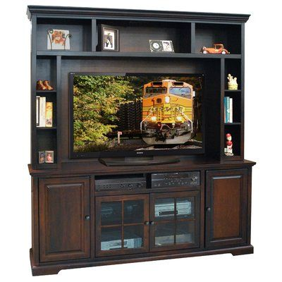 Transitionally designed to blend easily into both contemporary and traditional décor. It is constructed of solid wood with veneer and the back features knockouts for easy cable management. The console offers two glass front cabinets with adjustable shelves for storing your electronics, game systems, DVDs, and CDs.