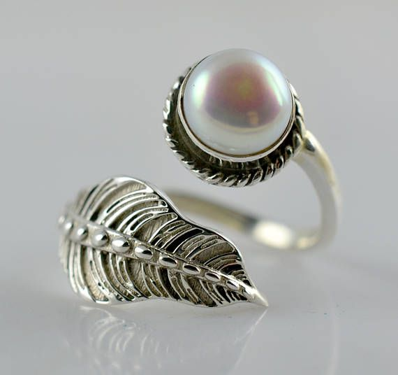 Silver Leaf and Fresh Water Pearl 925 Solid Sterling Silver Handmade Elegant designer Ring     Metal: Genuine 925 Solid Sterling Silver    Stone Used: Genuine Fresh Water Pearl    Stone Shape: Free Shape Round    Stone Size: 7.0 mm    Stone Color: Pearl White    Pretty pearls are such type gem Stones that can be worn casually during the day and may add a touch of individual glamour to an evening party.    Shaped as round, the best quality pearls will shimmer with a beautiful pearlescence…