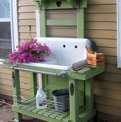 The sink is the original one from the kitchen in the house, salvaged from the cellar.Gardens Ideas, Pots Tables, Potting Tables, Potting Benches, Farms Sinks, Outdoor Sinks, Old Doors, Pots Benches, Kitchens Sinks