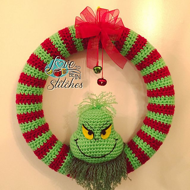 [Free Pattern] This Super-Cool Grinch Wreath Is Clearly One Of A Kind! - http://www.dailycrochet.com/free-pattern-this-super-cool-grinch-wreath-is-clearly-one-of-a-kind/
