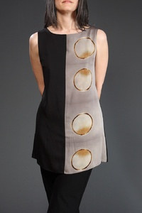 Half and Half Tunic with Rings Description: Lined, sleeveless tunic of silk georgette with surface design created using itajime shibori technique. All fabric is hand-dyed. Dimensions: H:34.00 x W:32.00 x D:0.00 Inches
