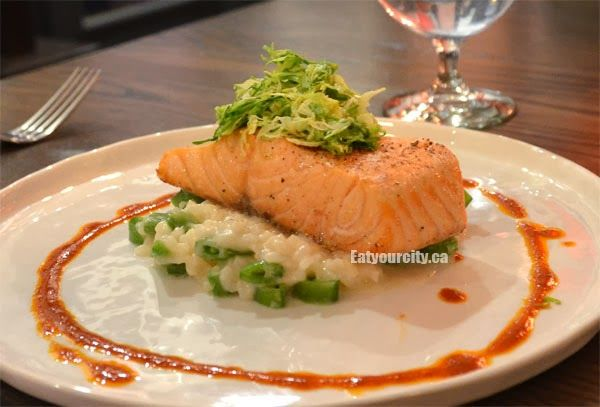 The River House Fresh Salmon with Snap Pea Risotto, Shaved Brussels Sprouts and Truffle Chili Dressing