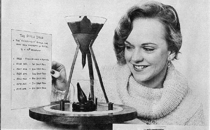 :: The Pitch Drop Experiment - In 1927 Professor Parnell heated a sample of pitch and poured it into a glass funnel with a sealed stem. Three years were allowed for the pitch to settle, and in 1930 the sealed stem was cut. From that date on the pitch has slowly dripped out of the funnel - so slowly that now, 80 years later, the ninth drop is only just forming. ::