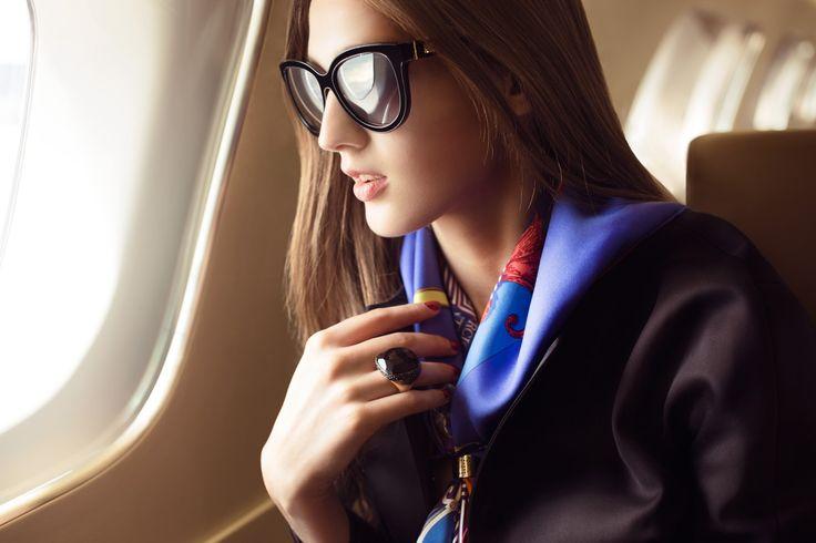 Private Jet Fashion Spread - Billionaire Black Dior: jacket, Hermes: silk twill scarf and gold ring scarf, Pomellato: Victoria black jet ring with diamonds, Giorgio: sunglasses, Executive jet: Embraer Lineage 1000E