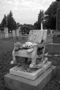 Mayflower Hill Cemetery Taunton, MA  Rocking Chair Monument: Many different legends have been told about Pearl's death, but she died from Spinal Meningtis at the age of 4. People still leave children's toys, flowers, etc.