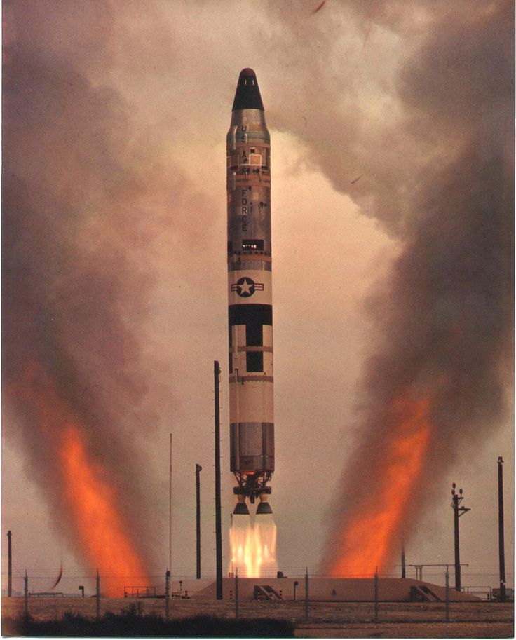 A Titan II intercontinental ballistic missile (ICBM) launched from an underground silo during the Cold War era.