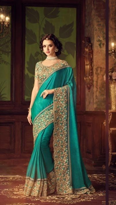 Price @5010.00 INR  Colour : Green  Saree Fabric : Silk  Blouse Fabric : Dupion  Work : Heavy Embroidery