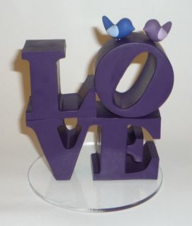 """""""LOVE"""" favor/rice bags are also available at https://www.etsy.com/listing/118794294/muslin-favor-bag-with-love-handstamped    **Photos are examples only** Custom Robert Indiana replica cake topper with birds available in any color. I can custom blend colors to match what you are looking for. This item is on a 4"""" diameter circle base and approx. 4"""" tall. The Love toppers are made of polymer clay which will last a lifetime with proper care (don't drop it or use harsh cleansers).    When…"""