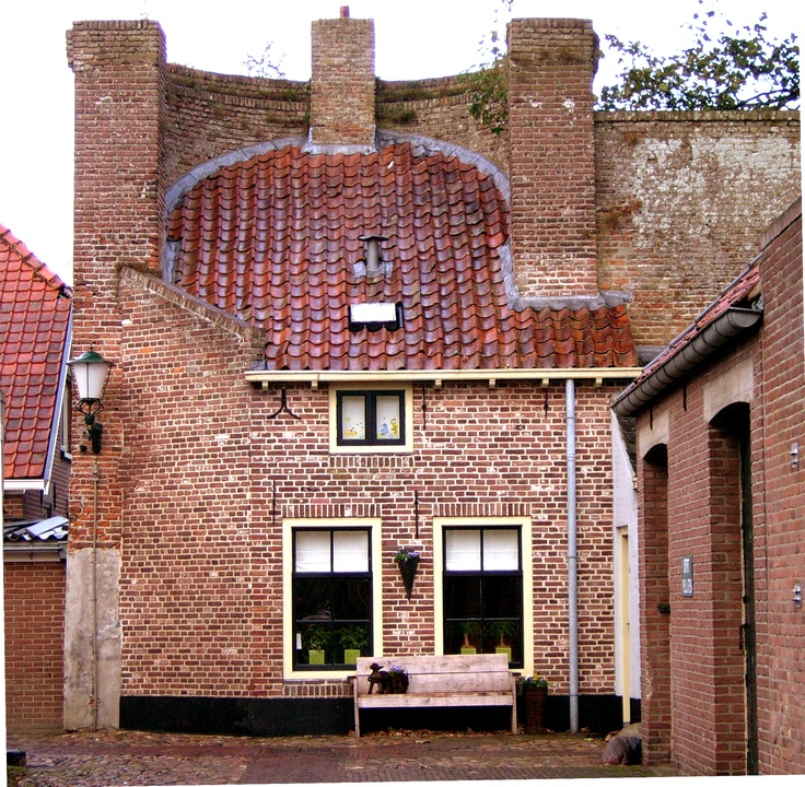 """House build in the citywall, called a """"rondeel"""" , Elburg, the Netherlands"""