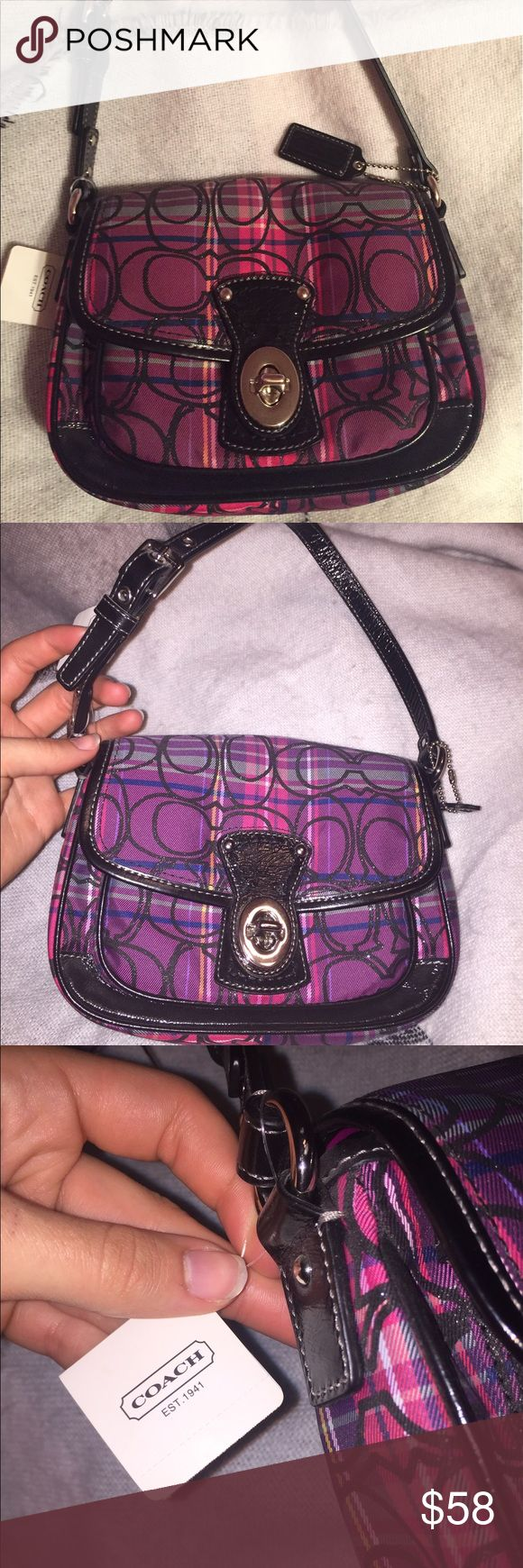 COACH Handbag A small but spacious little hand bag from coach. Never used and still has tags, pink plaid with black sparkly coach logos, black leather adjustable strap, metal turn lock on front, one large interior pocket and small outer pocket. Coach Bags Mini Bags