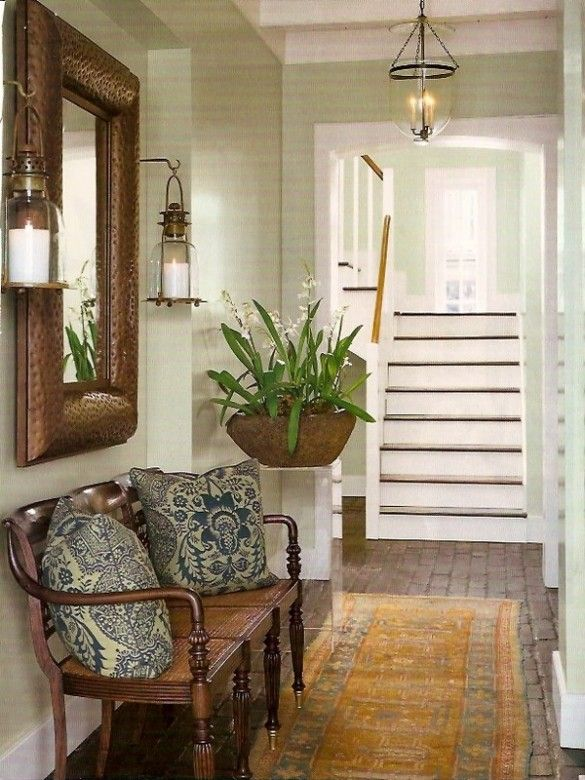 Entry - bench, mirror, sconces, fern, blue/white pillows, oriental rug and view of staircase.