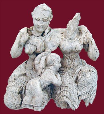 Mycenae. Fine ivory carving of two embracing women with a child playing at their laps.
