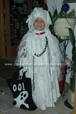 Homemade Spooky Ghost Halloween Costume: This Homemade Spooky Ghost Halloween Costume was made out of an old sheet. I cut a hole at the top and then hemmed around it leaving an opening. I pulled
